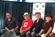 Farm Aid headliners participate in a press conference prior to the festival. During the conference, Willie Nelson (far right) was inducted into the National Agricultural Center and Hall of Fame. Pictured from left are Dave Matthews, Neil Young and John Mellencamp.