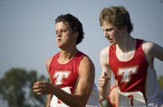 Tonganoxie High cross country teammates Clayton Himpel and Garrett French run side by side as they near the finish line Thursday at the Chieftains' season-opening dual against Lansing. THS prevailed, 33-24. Himpel finished seventh and French was eighth.