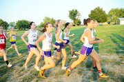 Members of the Baldwin High School girls' cross country team run as a pack early in Thursday's race at Garnett. From left, they are Kaitlyn Barnes, Abi Hartzell, Carol Whaley, Elena Watson and Sienna Durr. The Bulldogs easily won the Anderson County Invitational as a team.