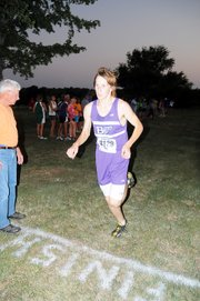 Baldwin High School sophomore Ethan Hartzell finishes the 5-kilometer race Thursday evening. He won the race in a time of 17:51.