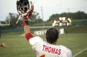 Tonganoxie High senior linebacker Adam Thomas celebrates while watching teammate Derek Lingo break a long run in the second quarter of the Chieftains' 34-6 road win Friday at Bishop Ward, in Kansas City, Kan.