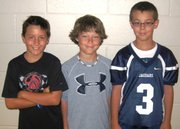 From left: Jacob Hoffman, Brock Denney and Charlie McGraw. The three Prairie Ridge Elementary fifth-graders will be recognized during Monday's De Soto school board meeting after they helped look after their crossing guard, Ed Vance, when they noticed him struggling to keep his balance last week.