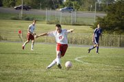 Tonganoxie junior Jared Colgrove moves the ball up the field in the second half of the Chieftains' 1-0 overtime victory against Piper on Wednesday.