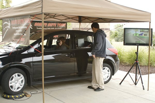 """DHS senior Anna Cline """"drives"""" a test vehicle while wearing goggles that simulate drunken driving during the Arrive Alive safe driving event at De Soto High School on Thursday, Sept. 15. """"It seemed pretty real and while I already don't drink and drive or text and drive this really showed me why it's so dangerous,"""" she said."""