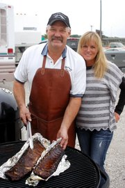 Joe and Lori Meyer display some of Joe&#39;s pork spareribs. The Shawnee residents lead Overland Pig Committee, one of 114 teams expected to compete at the 2011 Shawnee Great Grillers Blues &amp; Barbeque State Championship this weekend at Shawnee Town 1929.