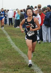 Bonner Springs freshman Akiko Capalla charges to the finish line during the Bonner Springs Invitational.