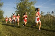 Tonganoxie High's Taylar Morgan, right, leads a pack of runners that includes Tressa Walker and Amanda Shepley Tuesday at the Tonganoxie Invitational, where the Chieftains finished third.