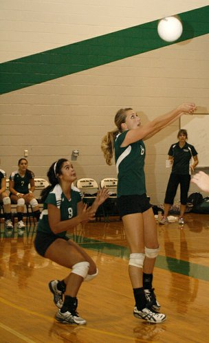 Senior Becca Maasen returns the volley to Louisburg with the support of teammate and fellow senior Danielle Dowdy during a home match on Tuesday, Sept. 20.