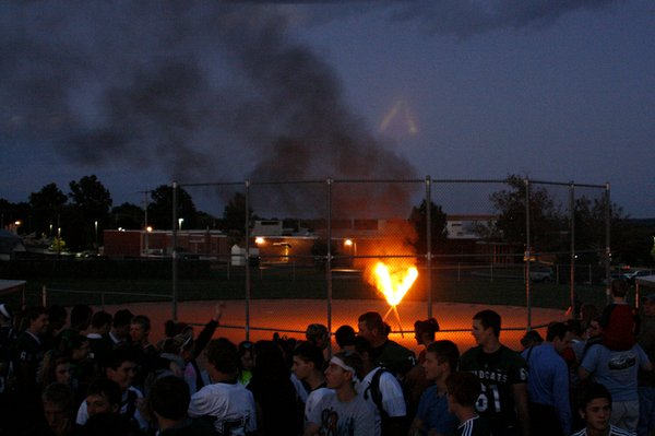 "A ""V"" for Victory burns on the De Soto High School practice softball field at the end of the school's fifth-annual, city-wide Spirit Rally for Homecoming on Thursday, Sept. 22."