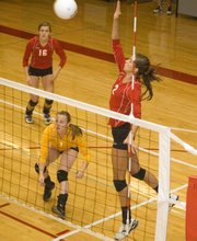 THS junior Jenny Whitledge rises up to send the ball over the net against Olathe East Saturday at the Tonganoxie Invitational. The Chieftains finished third at their home tournament.
