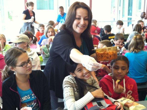 Amy Droegemeier, the De Soto school district's student nutrition director, serves up samples.