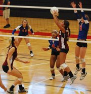 St. James Academy senior setter Paige Brown elevates for a pass during the Thunder's 25-23, 25-16 victory against Bishop Miege in the finals of the Joan Wells Invitational.