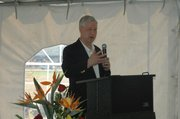 Steve Hewlett, CEO and general manager of Earp Distribution, addresses the crowd at the grand opening.