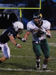 Basehor-Linwood receiver Ben Johnson tries to elude Mill Valley's Blake Miles. The Bobcats beat the Jaguars 42-21.