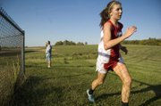 Tonganoxie High's Tressa Walker rounds a fence Thursday at the Pleasant Ridge Invitational. Walker took fifth place at the race and the THS girls finished second.