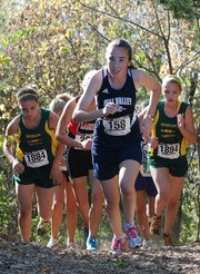 Mill Valley's Bailey Parke charges up the Bear Trail hill as Basehor-Linwood's Ally Laney, left, and Quinnlyn Walcott, right, close in early in the 4K girls race at the Kaw Valley League Championships.