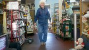 Evelyn VanKemseke, Shawnee Community Services founder and president, totes two bags of potatoes to the front of the store where clients could pick them up on Oct. 8. In recent weeks the charity has received 21,500 pounds of donated potatoes, with another 5,000 pounds expected to arrive Oct. 22.