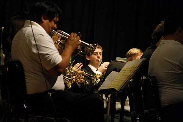 "The De Soto Brass Band is comprised of musicians of all ages and musical levels. Students as young as 13 play alongside those in their 70s. ""It's awesome for all of us to have this opportunity but especially so for the kids,"" said the band's Artistic Director and De Soto school music instructor Rob Foster. ""The older players are role models for the students and really help coach them."""