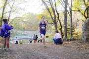 Baldwin High School sophomore Ethan Hartzell runs all alone during the final mile of Thursday's 5-kilometer Frontier League race. Hartzell finished runner-up, as did the BHS boys' team.