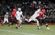 Baldwin High School junior Dayton Valentine sacks Ottawa's quarterback Connor Goedert during the first half Friday night.