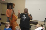 "Lisa Henry, a professional jazz singer from Kansas City, Mo., teaches the basic principals of math using jazz music and scat singing as inspiration. Henry visited the library Thursday, Oct. 20, to share a program called ""Ella, Scat & Math."""