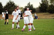 Baldwin High School senior Louis Joslyn, left, hugs his brother, sophomore Nick Joslyn, after the younger brother scored a goal Monday afternoon. The older Joslyn scored a goal later in the game as BHS beat Maranatha Academy 4-0.