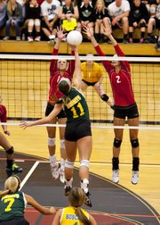 Tonganoxie High juniors Madee Walker and Jenny Whitledge go up for a block against Basehor-Linwood on Saturday in a first-round sub-state match at St. James Academy, in Lenexa. The Chieftains beat the Bobcats before losing to De Soto in a semifinal.