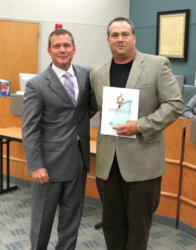 The USD 232 Board of Education recognized Rob Foster at its meeting on Oct. 10 for being named the Northeast Kansas Music Educators Association Outstanding Middle School Band Director of the Year. Superintendent Doug Sumner presented Foster a Certificate of Professional Achievement and the district's Inspiration Award.