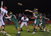 Basehor-Linwood quarterback Colin Murphy fires a pass downfield during the second half of the Bobcats&#39; 28-21 loss to Eudora in the Class 4A state playoffs.