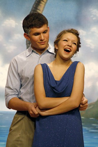 "DHS senior Owen Moore, portraying Emile De Becque, and senior Kassidy Forshey, portraying Nellie Forbush, sing during a dress rehearsal of the fall musical ""South Pacific."""