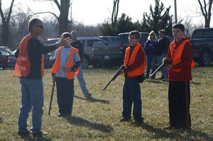 Floyd Pearson, hunter safety instructor, guides some students through a practice walk out during a safety course on Saturday, Nov. 19. The goal of the walk out is to practice safe gun handling and safe spotting in the field.