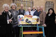 Dr. Phil Stevens' entire family met at his office Friday to move in a bench made in his honor. Pictured, from left, are Dr. Phil's wife, Betty Stevens, daughter Lisa Scheller, son Chuck Stevens, Dr. Phil, sons Phillip, Danny and Matt, and daughter Loralee Stevens.