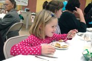Jaidyn Hanks, 6, of Platte City, Mo., enjoys a slice of pumpkin pie.