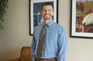 J.J. Schmidt is a chiropractor who practices in Shawnee. This year he&#39;s giving back to the Johnson County Christmas Bureau, volunteering for the Holiday Shop that once helped his family eight years ago.