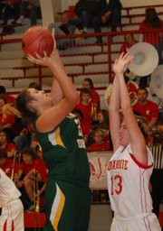 Basehor-Linwood senior Bailey Hooker goes up for two of her eight points during the Bobcats' 41-38 victory at Tonganoxie.