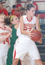 Tonganoxie&#39;s Jenny Whitledge hauls in a rebound against Basehor-Linwood. BLHS won 41-38.