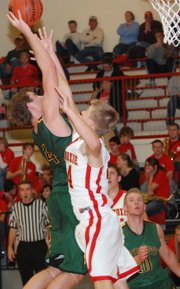 Basehor-Linwood's Colin Murphy draws a foul on his way to the basket during a 74-38 victory at Tonganoxie.