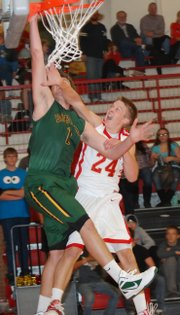 Tonganoxie&#39;s Ben Williams fouls Basehor-Linwood&#39;s Ryan Murphy to prevent Murphy from throwing down a dunk during the second half of the Bobcats&#39; 74-38 victory in the season-opener.