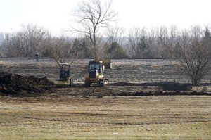 GBT Realty crews excavate soil in the first stages of construction on the new Dollar General store at the intersection of Lexington and Penner Avenues in De Soto on Thursday, Dec. 8.
