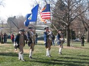 Members of the Kansas Society of the Sons of the American Revolution present colors during the Wreaths Across America ceremony Saturday at Leavenworth National Cemetery.