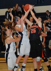 Bonner Springs' Emily Wilson is fouled by Mill Valley's Tanner Tripp. BSHS beat MVHS 38-37.