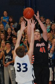 Bonner Springs forward Brett Steuart puts up a jumper over Mill Valley's Nathan Stacy during the first half of the Braves' 55-52 victory.