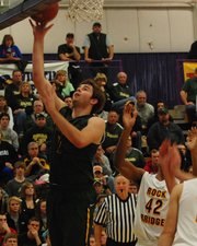 Basehor-Linwood's Ryan Murphy lays the ball in during the Bobcats' fourth-quarter comeback against Columbia (Mo.) Rock Bridge at the Hy-Vee Shootout. BLHS erased a 13-point deficit and won 67-60 in overtime.