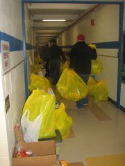 In the halls of Basehor Elementary School on Friday, Dec. 16, Basehor-Linwood Assistance Services volunteers sort bags of gifts for the 36 families receiving holiday help from the BLAS Adopt-a-Family program in 2011.