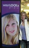 Olivia Cline, 16, poses for a photo next to an advertisement she appears in at the Great Wolf Lodge in Kansas City, Kan. Cline has been modeling for approximately three years and this is her biggest ad yet.