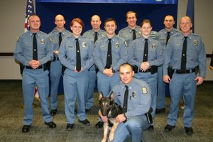Nine new deputies and one K-9 officer were honored today during a pinning ceremony by Johnson County Sheriff Frank Denning on Thursday, Jan. 4. Front row: Deputy Travis Turner and K-9 Nora. Middle Row, from left to right: Daniel Stach, Sabrina Sherman, Adam Livengood, Lauren Andreasen and Chad Jennings. Back Row, from left to right: Clinton Peterson, Tanner McGee, Skyler Johnson and Benjamin Giffin.