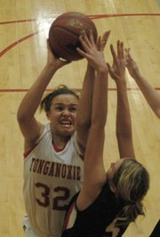 Tonganoxie's Tavia Brown puts up a shot against Lansing's Gabby Hacker.