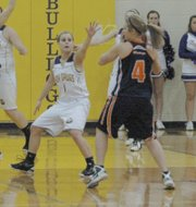 McLouth's Terri Stewart guards Doniphan West's Clarissa Billups.
