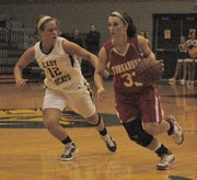 Tonganoxie's Hannah Kemp, right, drives against Basehor-Linwood's Amber Garver.