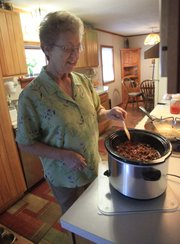 Helga Barton of Lawrence uses her crock pot to make easy, inexpensive meals.